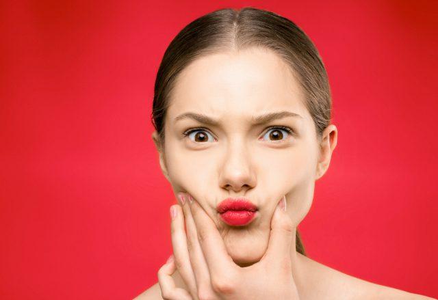 Jak dobrać czerwoną szminkę do stylizacji?